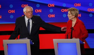 Sen. Bernie Sanders, I-Vt., gestures toward Sen. Elizabeth Warren, D-Mass., during the first of two Democratic presidential primary debates hosted by CNN Tuesday, July 30, 2019, in the Fox Theatre in Detroit. (AP Photo/Paul Sancya) ** FILE **