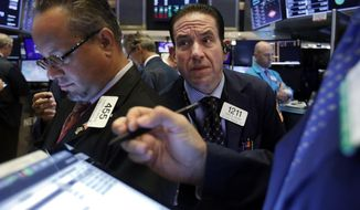 FILE - In this July 31, 2019, file photo trader Tommy Kalikas, center, works on the floor of the New York Stock Exchange. Stocks took a nosedive and bond prices spiked after President Donald Trump said the U.S. would raise tariffs on more Chinese goods, increasing the stakes in an ongoing trade battle. The market had been on track for its biggest gain in nearly two months Thursday, Aug. 1. (AP Photo/Richard Drew, File)