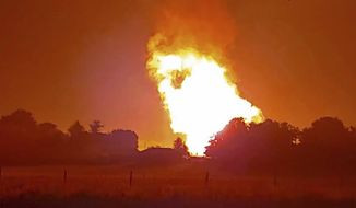 In this Thursday, Aug. 1, 2019, photo provided by Naomi Hayes, a fire burns after an explosion near Junction City, Ky. A regional gas pipeline ruptured early Thursday in Kentucky, causing a massive explosion that killed one person, hospitalized five others, destroyed railroad tracks and forced the evacuation of a nearby mobile home park, authorities said. (Naomi Hayes via AP)