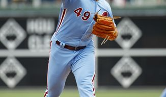 Philadelphia Phillies starting pitcher Jake Arrieta throws a pitch during the first inning of a baseball game against the San Francisco Giants, Thursday, Aug. 1, 2019, in Philadelphia. (AP Photo/Chris Szagola)