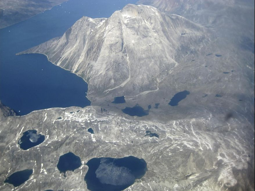 In this image taken on June 22, 2019, an aerial view of melt water lakes on the edge of an ice cap in Nunatarssuk, Greenland. Milder weather than normal since the start of summer, led to the U.N.'s weather agency voicing concern that the hot air which produced the recent extreme heat wave in Europe could be headed toward Greenland where it could contribute to increased melting of ice. (AP Photo/Keith Virgo)