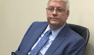 Ousted Iowa Department of Human Services director Jerry Foxhoven sits at a news conference Thursday, Aug. 1, 2019, in West Des Moines, Iowa, where he said aides to Gov. Kim Reynolds are lying when they say he never objected to paying the salary of a governor's staffer out of his budget. Foxhoven, a 67-year-old legal scholar known for his frequent workplace praise of the late rapper Tupac Shakur, said he raised the issue more than once and declined to agree to pay most of the salary of the governor's deputy chief of staff, Paige Thorson, without legal advice. (AP Photo/David Pitt)