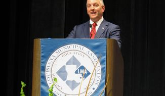 Democratic Gov. John Bel Edwards speaks at the Louisiana Municipal Association convention on Thursday, Aug. 1, 2019, in Monroe, La. Edwards and Republican challenger Ralph Abraham made spending promises to sheriffs Thursday while offering diverging tax pitches to mayors and municipal leaders, as the pair traveled to campaign forums on opposite ends of Louisiana seeking to woo local officials' support in the governor's race. (AP Photo/Melinda Deslatte)