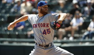 New York Mets starting pitcher Zack Wheeler delivers during the first inning of a baseball game against the Chicago White Sox Thursday, Aug. 1, 2019, in Chicago. (AP Photo/Charles Rex Arbogast)