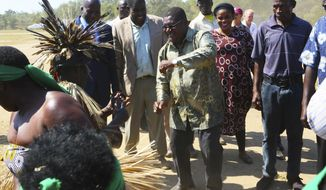 Renamo leader Ossufo Momade, center, performs a dance with locals upon his arrival for a peace accord signing ceremony at Gorongosa National Park, about 170 kilometres from Beira, Mozambique, Thursday, Aug, 1, 2019. Momade is set to sign a peace agreement with Mozambique President Filipe Nyusi, ending decades of hostilities that included a 15 year civil war. The former rebel groups remaining fighters are disarming just weeks before a visit by Pope Francis and a national election that will test the now-political rivals new resolve. (AP Photo/Tsvangirayi Mukwazhi)