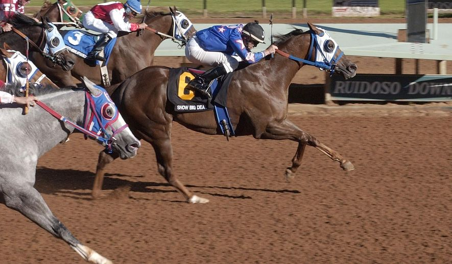 FILE - In this Aug. 31, 2003, file photo, Joe Badilla Jr. rides Snow Big Deal (6) to a win in the All American Derby in Ruidoso Downs, N.M. The New Mexico Racing Commission announced Thursday, Aug. 1, 2019, it would not approve a sixth state horse track and casino license following months of debates and millions of dollars spent by applicants. (AP Photo/Jake Schoellkopf, File)