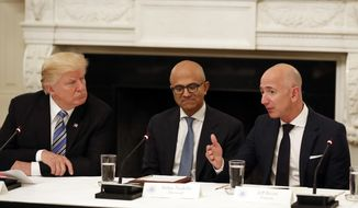 In this June 19, 2017, file photo, President Donald Trump, from left, and Satya Nadella, chief executive officer of Microsoft, listen as Jeff Bezos, chief executive officer of Amazon, speaks during an American Technology Council roundtable in the State Dining Room of the White House in Washington. The Pentagon says new Secretary of Defense Mike Esper is reviewing the bid process for the military's $10 billion cloud-computing contract. (AP Photo/Alex Brandon, File)
