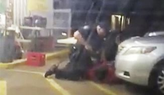 FILE - In this July 5, 2016, file image taken from video, Alton Sterling is restrained by two Baton Rouge police officers, one holding a gun, outside a convenience store in Baton Rouge, La. The Baton Rouge police chief is apologizing to the city and to the family of a black man shot and killed by a former police officer in 2016. Chief Murphy Paul said at a Thursday, Aug. 1,2019, news conference that Officer Blane Salamoni should have never been hired. (Arthur Reed via AP, File)