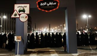In this June 22, 2018, file photo, women wait in line to ride go carts at a road safety event for female drivers launched at the Riyadh Park Mall in Riyadh. Saudi Arabia has issued new laws that grant women greater freedoms by allowing any citizen to apply for a passport and travel freely, ending a long-standing and controversial guardianship policy that had required male consent for a woman to travel or carry a passport. (AP Photo/Nariman El-Mofty, File)