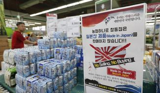 """In this July 12, 2019, photo, a notice campaigning for a boycott of Japanese-made products is displayed in Seoul, South Korea. The sign reads: """"We don't sell Japanese products."""" A widespread anti-Japanese boycott has gained ground in South Korea since Tokyo tightened its exports of materials used to manufacture semiconductors and display screens, key export items for South Korea.(AP Photo/Ahn Young-joon)"""