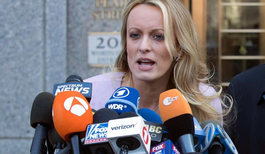 FILE - In this April 16, 2018, file photo, adult film actress Stormy Daniels speaks outside federal court in New York. Columbus police say five officers from the department's now-disbanded vice unit face discipline for the 2018 raid on a strip club that resulted in the arrest of Stormy Daniels. The department said Wednesday, July 31, 2019, that the officers could face punishment ranging from a reprimand to firing. The officers include a commander, lieutenant, sergeant and two of the arresting officers.(AP Photo/Mary Altaffer, File)