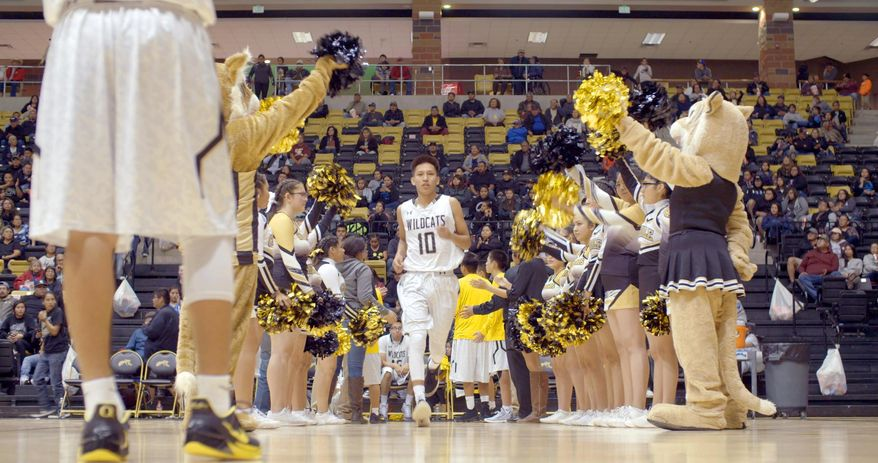 """This image released by The WorkShop shows a scene from """"Basketball or Nothing,"""" a new docuseries that examines the hoops dreams of a rural, Arizona town in the heart of the Navajo Nation. The six-episode series debuts Friday on Netflix. (The WorkShop via AP)"""