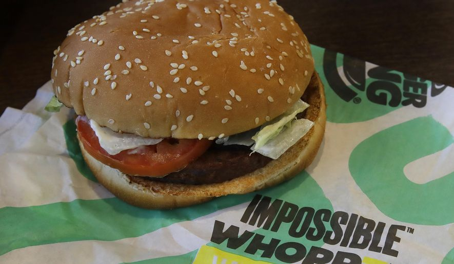 In this Wednesday, July 31, 2019, photo, an Impossible Whopper burger is photographed at a Burger King restaurant in Alameda, Calif. (AP Photo/Ben Margot) ** FILE **