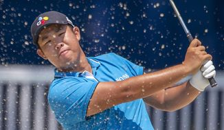 Byeong Hun An, of South Korea, hits from a sand trap on the 18th hole during the first round of the Wyndham Championship golf tournament in Greensboro, N.C., Thursday, Aug. 1, 2019. (H. Scott Hoffmann/News & Record)