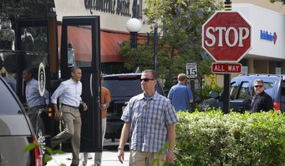President Barack Obama steps off his campaign tour bus during an unannounced stop visit at Ossorio Bakery and Cafe, Sunday, Sept. 9, 2012, in Cocoa, Fla. (AP Photo/Pablo Martinez Monsivais)