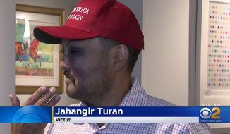 "Jahangir Turan, the owner of the David Parker Gallery in Manhattan, said he suffered a broken cheekbone Tuesday after he was attacked by a group of teens because he was wearing a ""Make America Great Again"" hat. (CBSNewYork)"