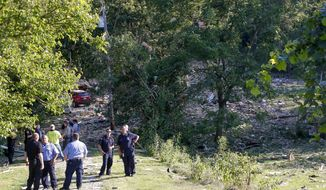 First responders gather near the area where an explosion believed to have been caused by a gas leak, reduced a western Pennsylvania home to a pile of rubble and sent at least four people to hospitals, Wednesday, July 31, 2019, in North Franklin Township, in Washington, Pa. (AP Photo/Keith Srakocic)