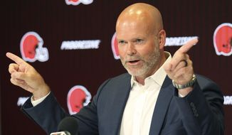 Former Cleveland Browns kicker Phil Dawson explains to the media how the wind blows the flags on the goal posts in opposite directions during his announces of his retirement from the NFL, Friday, Aug. 2, 2019, retiring as a Cleveland Brown at the team's headquarters in Berea, Ohio. (John Kuntz/The Plain Dealer via AP)