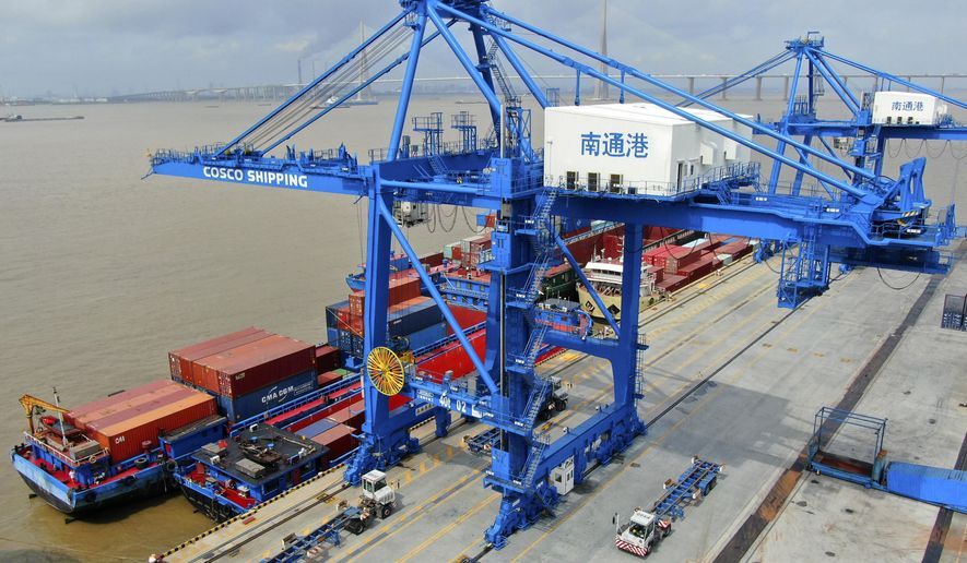 In this July 18, 2019, photo, shipping containers are loaded onto a cargo ship at a port in Nantong in eastern China's Jiangsu province. President Donald Trump intensified pressure on China to reach a trade deal by saying he will impose 10% tariffs Sept. 1 on the remaining $300 billion in Chinese imports he hasn't already taxed. (Chinatopix via AP)