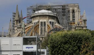 Scaffolding platforms are set up at Notre Dame Cathedral, in Paris, Thursday, Aug. 1, 2019, as the preliminary work begins to repair the fire damage. (AP Photo/Michel Euler)