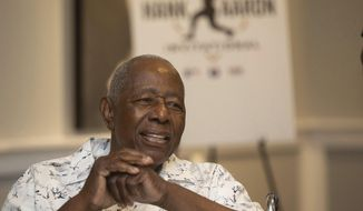 Hank Aaron answers questions from the crowd during the Hank Aaron Invitational at SunTrust Park in Atlanta, Aug. 2, 2019. (Steve Schaefer/Atlanta Journal-Constitution via AP)