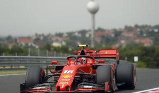 Ferrari driver Charles Leclerc of Monaco steers his car during the first practice session of the Hungarian Formula One Grand Prix at the Hungaroring racetrack in Mogyorod, northeast of Budapest, Hungary, Friday, Aug. 2, 2019. The Hungarian Formula One Grand Prix takes place on Sunday. (AP Photo/Laszlo Balogh)