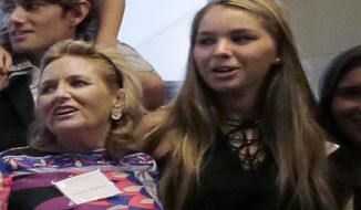 In this Sept. 20, 2016, photo, Saoirse Kennedy Hill, right, granddaughter of Ethel Kennedy and her late husband Robert F. Kennedy, poses for a family group photo with her mother Courtney Kennedy Hill, left, after a ceremony for naming the Robert Kennedy Navy Ship at the John F. Kennedy Presidential Library, in Boston. Saoirse Kennedy Hill died Thursday, Aug. 1, 2019, at the Kennedy compound in Hyannis Port, Mass. She was 22. (AP Photo/Elise Amendola)
