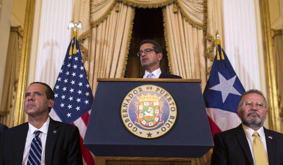 Pedro Pierluisi, sworn in as Puerto Rico's governor, speaks during a press conference, in San Juan, Puerto Rico, Friday, Aug. 2, 2019. (AP Photo/Dennis M. Rivera Pichardo)