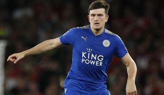 FILE  - In this Friday, Aug. 11, 2017 file photo, Leicester City's Harry Maguire looks to pass the ball during their English Premier League soccer match between Arsenal and Leicester City at the Emirates stadium in London. A person with knowledge of the deal says Manchester United is set to break the world transfer record for a defender after agreeing to pay 80 million pounds ($97 million) to sign Harry Maguire from Leicester. The person spoke on condition of anonymity because the transfer is yet to be finalized.  (AP Photo/Alastair Grant, File)
