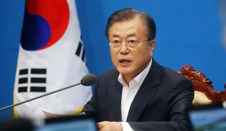 "South Korean President Moon Jae-in speaks during an emergency cabinet meeting at the presidential Blue House in Seoul, South Korea, Friday, Aug. 2, 2019. Moon has vowed stern countermeasures against Japan's decision to downgrade its trade status, which he described as a deliberate attempt to contain South Korea's economic growth and a ""selfish"" act that would damage global supply chains.(Bae Jae-man/Yonhap via AP)"