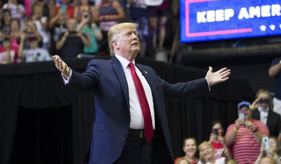 President Donald Trump arrives to speak at a campaign rally Thursday, Aug. 1, 2019, in Cincinnati. (AP Photo/Alex Brandon)