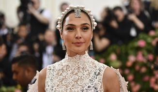 "Gal Gadot attends The Metropolitan Museum of Art's Costume Institute benefit gala celebrating the opening of the ""Camp: Notes on Fashion"" exhibition in New York, May 6, 2019. (Photo by Charles Sykes/Invision/AP)  ** FILE **"