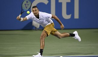 Nick Kyrgios, of Australia, returns the ball to Norbert Gombos, of Slovakia, during the Citi Open tennis tournament Friday, Aug. 2, 2019, in Washington. (AP Photo/Nick Wass) ** FILE **
