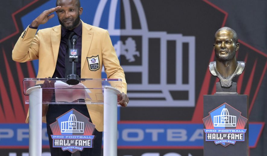 Former NFL player Champ Bailey speaks during the induction ceremony at the Pro Football Hall of Fame, Saturday, Aug. 3, 2019, in Canton, Ohio. (AP Photo/David Richard)