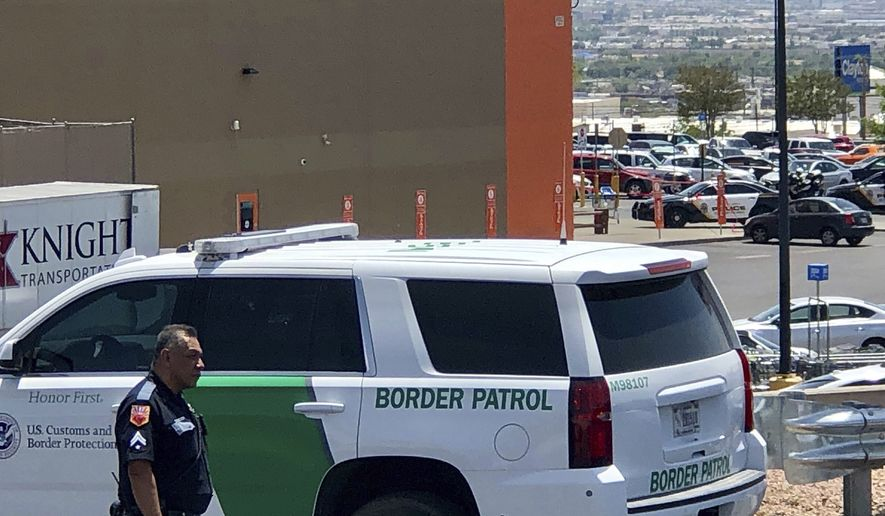Law enforcement work the scene of a shooting  at a shopping mall in El Paso, Texas, on Saturday, Aug. 3, 2019.   Multiple people were killed and one person was in custody after a shooter went on a rampage at a shopping mall, police in the Texas border town of El Paso said. (AP Photo/Rudy Gutierrez)