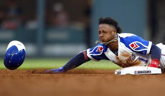 Atlanta Braves second baseman Ozzie Albies steals second base in the third inning of a baseball game against the Cincinnati Reds, Saturday, Aug.3, 2019, in Atlanta. (AP Photo/Todd Kirkland)