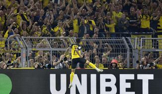 Dortmund's Jadon Sancho celebrates after scoring his side's second goal during the German Supercup final soccer match between Borussia Dortmund and Bayern Munich in Dortmund, Germany, Saturday, Aug. 3, 2019. (AP Photo/Martin Meissner)