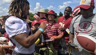 Washington Redskins running back Derrius Guice signs autographs for fans at training camp in Richmond, Virginia, on Saturday, Aug. 3, 2019. (Photo by Rina Torchinsky / The Washington Times)