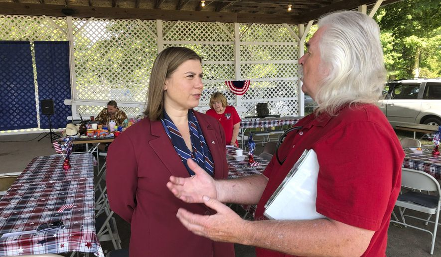 Rep. Elissa Slotkin, D-Mich., talks with a constituent after a veterans event on Friday, Aug. 2, 2019, at the Ingham County Fair in Mason, Mich. Slotkin, who flipped the 8th Congressional District by defeating a Republican incumbent in 2018, has not backed an impeachment inquiry of President Donald Trump. (AP Photo/David Eggert)