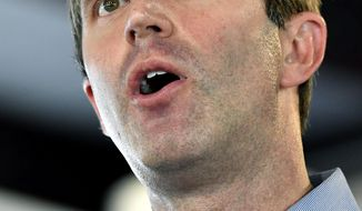 Kentucky democratic candidate for governor Attorney General Andy Beshear addresses the audience gathered at the Fancy Farm Picnic in Fancy Farm, Ky., Saturday, Aug. 3, 2019. (AP Photo/Timothy D. Easley)
