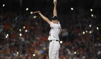 Houston Astros starting pitcher Aaron Sanchez stretches on the mound during the sixth inning of the team's baseball game against the Seattle Mariners, Saturday, Aug. 3, 2019, in Houston. (AP Photo/Eric Christian Smith)