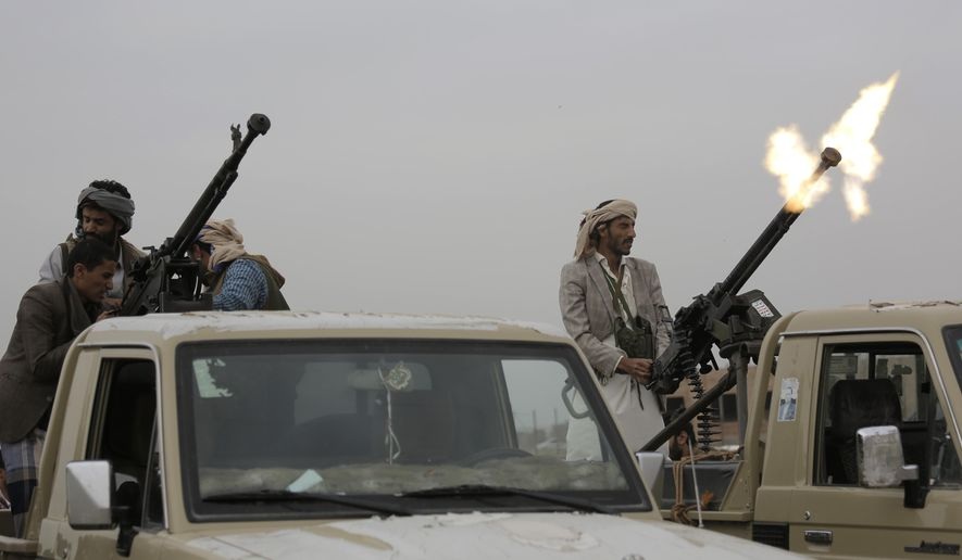 A Houthi rebel fighter fires in the air during a gathering aimed at mobilizing more fighters for the their movement, in Sanaa, Yemen, Thursday, Aug. 1, 2019. The conflict in Yemen began with the 2014 takeover of Sanaa by the Houthis, who drove out the internationally-recognized government. Months later, in March 2015, a Saudi-led coalition launched its air campaign to prevent the rebels from overrunning the country's south. (AP Photo/Hani Mohammed) **FILE**