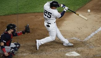 New York Yankees' Gleyber Torres (25) hits a solo home run during the fifth inning in the second baseball game of the team's doubleheader against the Boston Red Sox, Saturday, Aug. 3, 2019, in New York. Red Sox catcher Christian Vazquez is behind the plate. (AP Photo/Kathy Willens)