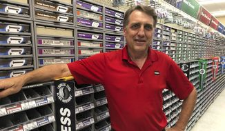 In this July, 31, 2019 photo, business owner Jeff Hinz poses for a photo at his hardware store in Bismarck, North Dakota. North Dakotans will be allowed to shop on Sunday morning for the first time since statehood. But Hinz says he will continue to be closed on Sunday mornings to attend church. (AP Photo/James MacPherson)