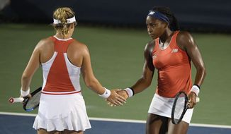 "Cori ""Coco"" Gauff, right, slaps hands with Catherine McNally, left, during a doubles match against Anna Kalinskaya, of Russia, and Miyu Kato, of Japan, in the Citi Open tennis tournament Friday, Aug. 2, 2019, in Washington. (AP Photo/Nick Wass)"
