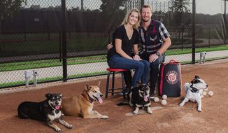 Max and Erica Scherzer sit with their four rescue dogs Bo, GiGi, Rafi and Rocco for the Washington Nationals' 2020 Pet Calendar, available now. (Paul Kim/Special to The Washington Times)