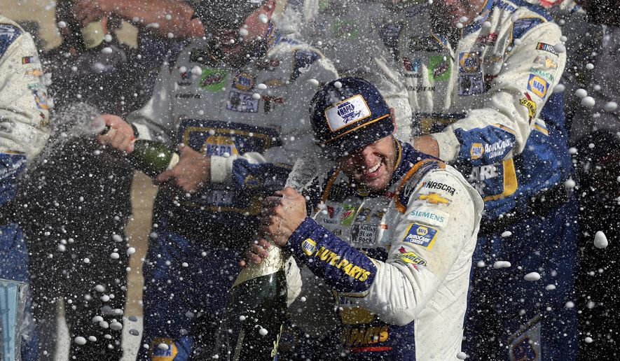 Chase Elliott celebrates his victory with his pit crew after winning a NASCAR Cup Series auto race at Watkins Glen International, Sunday, Aug. 4, 2019, in Watkins Glen, N.Y. (AP Photo/John Munson)