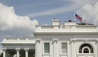 The American flag flies at half-staff at the White House in Washington, Sunday, Aug. 4, 2019, to honor those killed in two mass shootings, one in Dayton, Ohio and one in El Paso, Texas. (AP Photo/Andrew Harnik)
