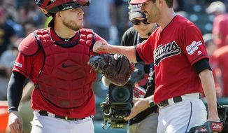 Cleveland Indians' Roberto Perez, left, and starter Shane Bieber celebrate their win over the Los Angeles Angels in a baseball game in Cleveland, Sunday, Aug. 4, 2019. (AP Photo/Phil Long)