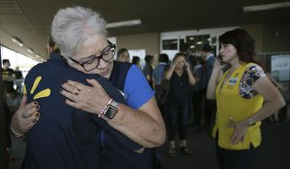 Walmart employees comfort one another after an active shooter opened fire at the store in El Paso, Texas, Saturday, Aug. 3, 2019. (Mark Lambie/The El Paso Times via AP)